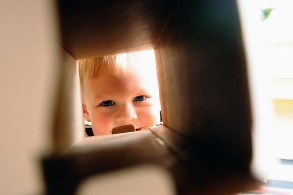 A child peeking through a moving box