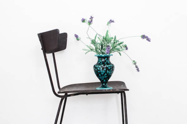 chair and a vase with flowers as furnishing